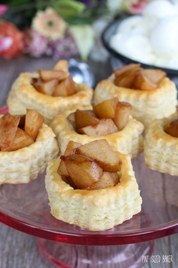 Pear Puffed Pastry Tarts served on a rose colored glass plate.