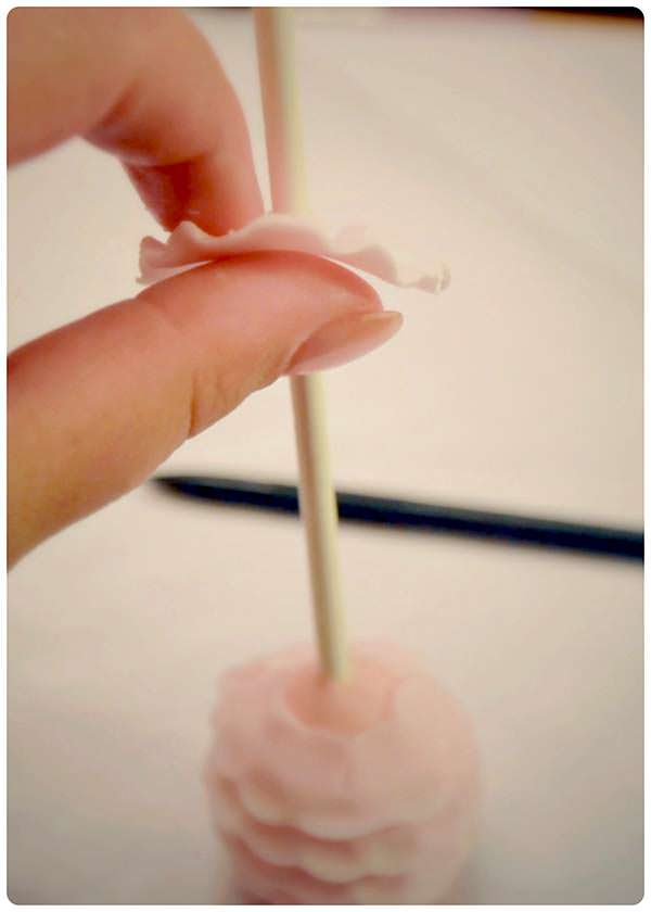 thread the top ruffle on to the cake pop.