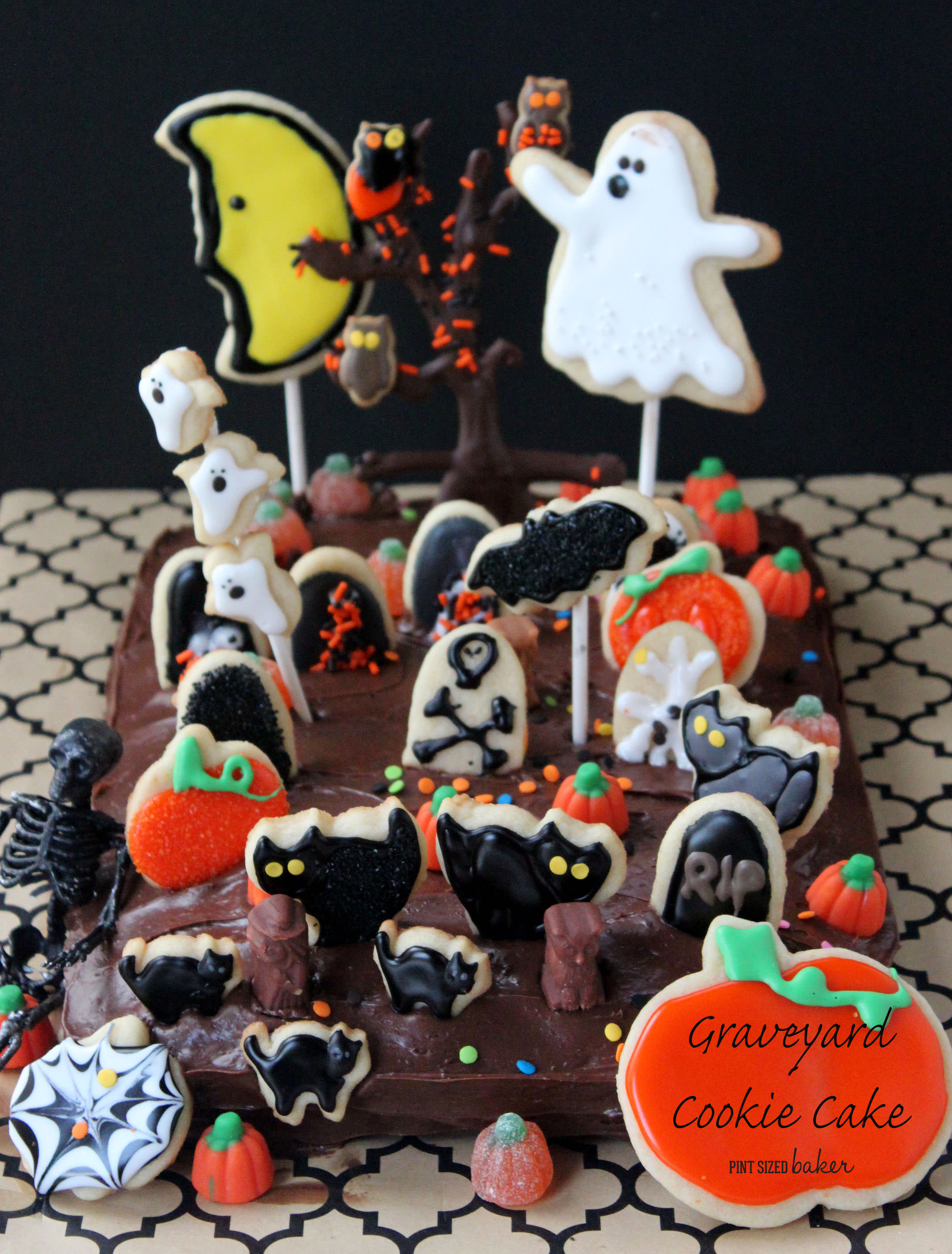 The kids are going to LOVE baking, decorating, and creating this fun Graveyard Cake for Halloween! Cookie decoration on a sheet cake!