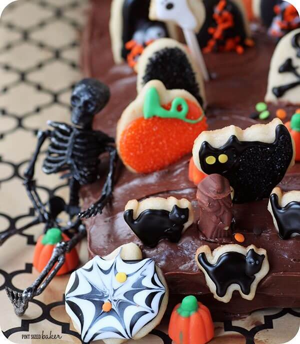 The kids are going to LOVE baking, decorating, and creating this fun Graveyard Cake for Halloween! Cookie decorations on a sheet cake!