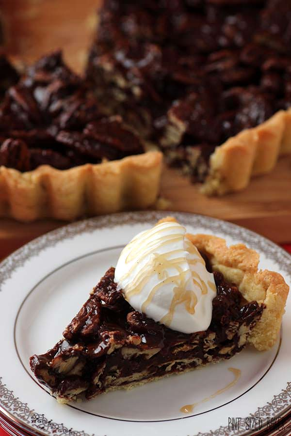 A sweet drizzle of butterscotch over a chocolate buttercsotch pecan tart. It's an amazing dessert.