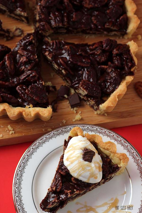 Sweet and easy - this chocolate pecan tart with soft whipped cream and butterscotch drizzle. It's a perfect dessert.