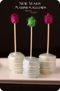 White Chocolate covered Marshmallows are glammed up for their New Year's Party! from #dietersdownfall.com