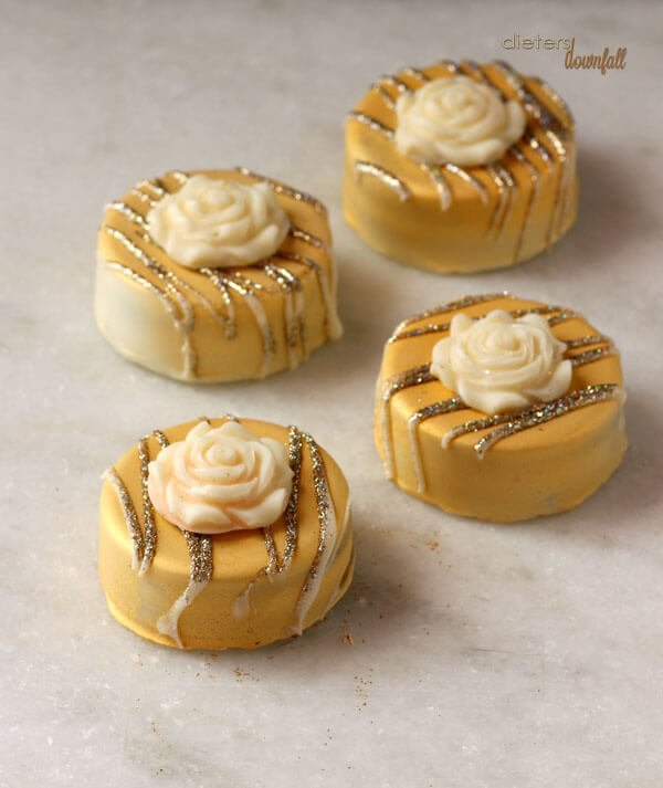 Chocolate Covered Oreo's dressed in gold and diamonds. Cookies are also a girl's best friend. from #dietersdownfall.com
