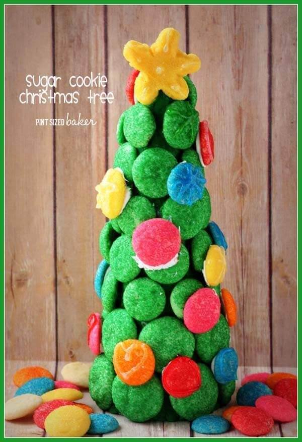 Learn how easy it is to make this beautiful Sugar Cookie Christmas Tree with your kids. It's a great accessory to a gingerbread house!