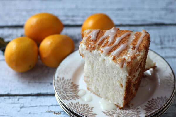 Luscious Meyer Lemon Angel Food Cake with a touch of Lemon Glaze. A light, citrus favorite. from #dietersdownfall.com