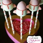 Whoosh! These Rocket Ship Cake Pops from Cake Poppin are so cute! They are the perfect way to tell someone that you love them to the moon and back!