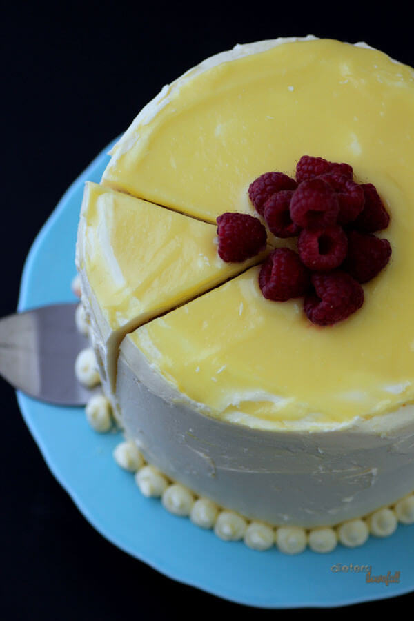Slice into this towering lemon and raspberry cake. It's perfect for a gathering. from #DietersDownfall.com