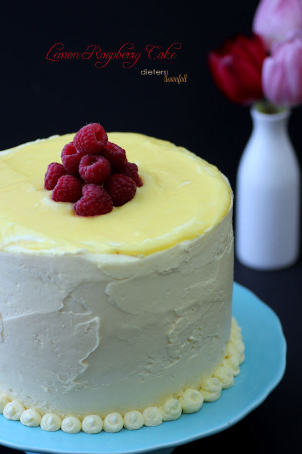 Lemon and Raspberry Cake filled with fresh lemon curd and rich buttercream frosting. from #DietersDownfall.com