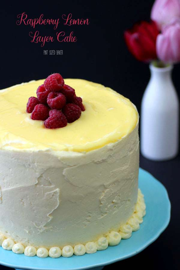 This amazing Raspberry Lemon Layer Cake is made with a white lemon sponge cake, homemade lemon curd, and sweet lemon buttercream frosting.