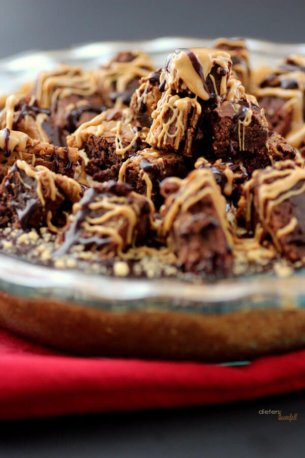 Peanut Butter Pie piled high with peanut butter brownies and topped with peanut butter and chocolate. from #dietersdownfall.com