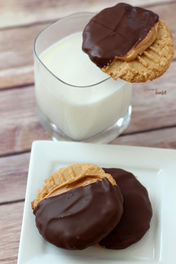 Peanut Butter Cookies slathered in creamy peanut butter then dipped in chocolate. Perfect! from #dietersdownfall.com