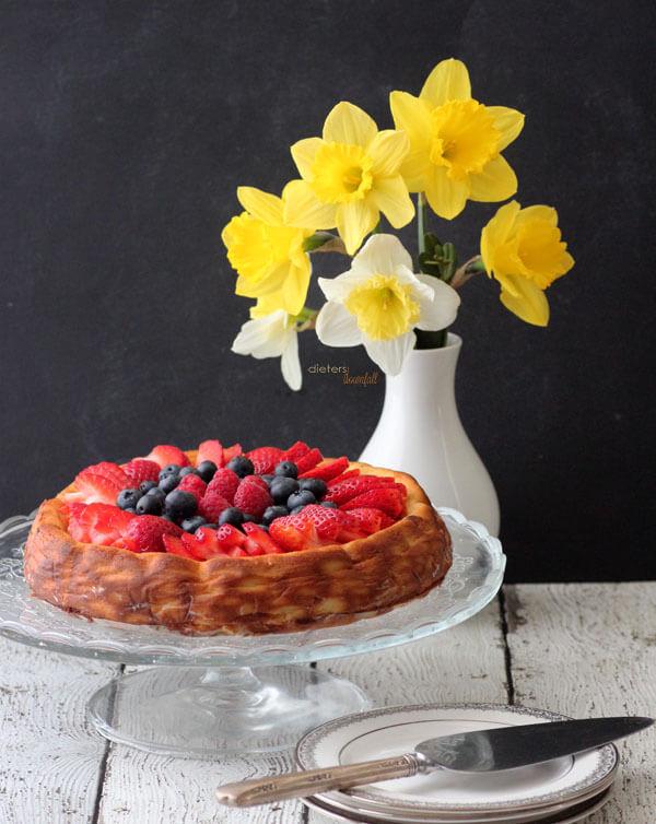 Crustless Ricotta Cheesecake with lemon zest and fresh berries. from #dietersdownfall.com