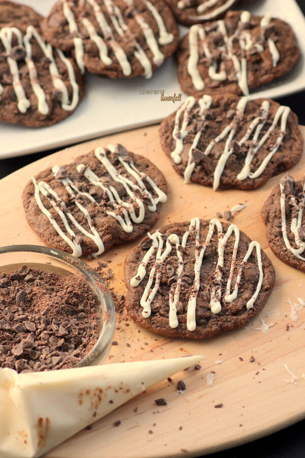 Chocolate Mint Chip Cookies with White Chocolate drizzle and crushed chocolate on top. from #DietersDownfall.com