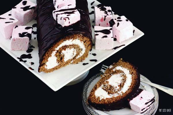 Decadent Marshmallow Roulade. A Roll Cake with seven minute frosting and topped with homemade marshmallows.