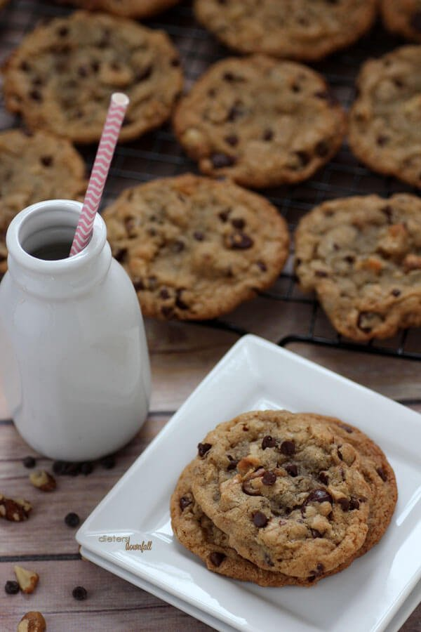 An image of a plate of cookies and a jar of milk for the perfect treat at the end of the day.