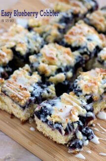 An Easy Blueberry Cobbler recipe that is quick to whip up and serves a crowd! It'll be your new go-to pot luck dessert!