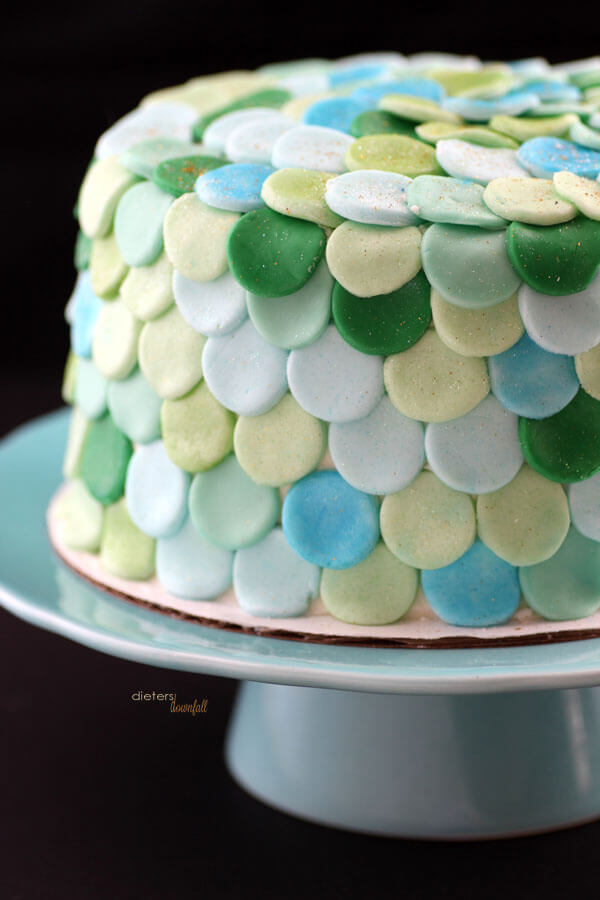 Multiple shades of green and blue make up this Mermaid inspired cake. from #DietersDownfall.com