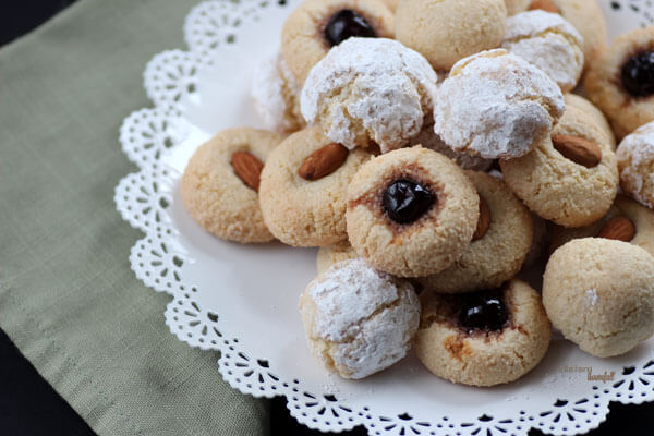 Amaretti Cookies coated in powdered sugar, topped with a cherry or almond or served plain. from #DietersDownfall.com