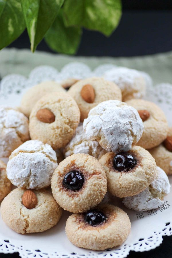 Up close image of the Amaretti Cookies on a white platter. You can see the details in the cookie texture.