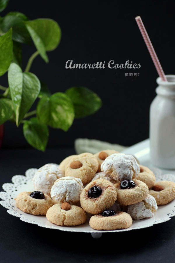 Lead in image of the Amaretti Cookies piled on a white platter. You can see the three different types of toppings I used on the cookies.