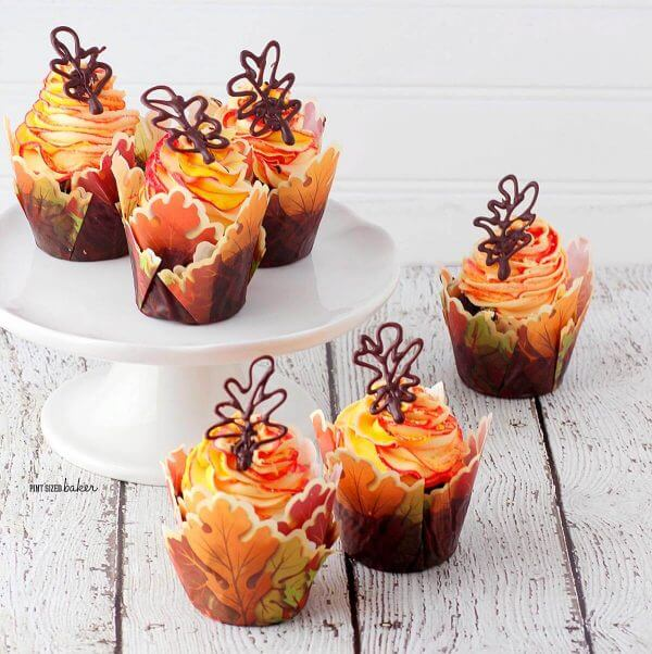 You won't believe how easy these fall leaves cupcakes were to decorate. Yellow and Orange frosting with chocolate leaves are so stunning for your Autumn Party.