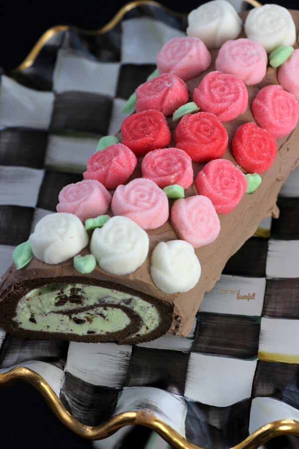 Perfect ombre roses adorn this perfect mint chip ice cream roll cake. from #DietersDownfall