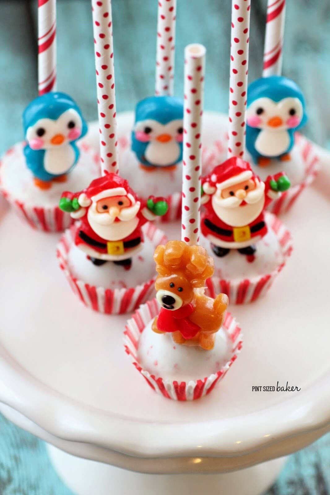 These Easy Christmas Cake Pops are so simple to make and look so adorable! Pick up the gummy candies at the store and make them for your holiday party.