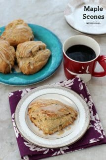 Maple Scones on a small plate with a cup of coffee.