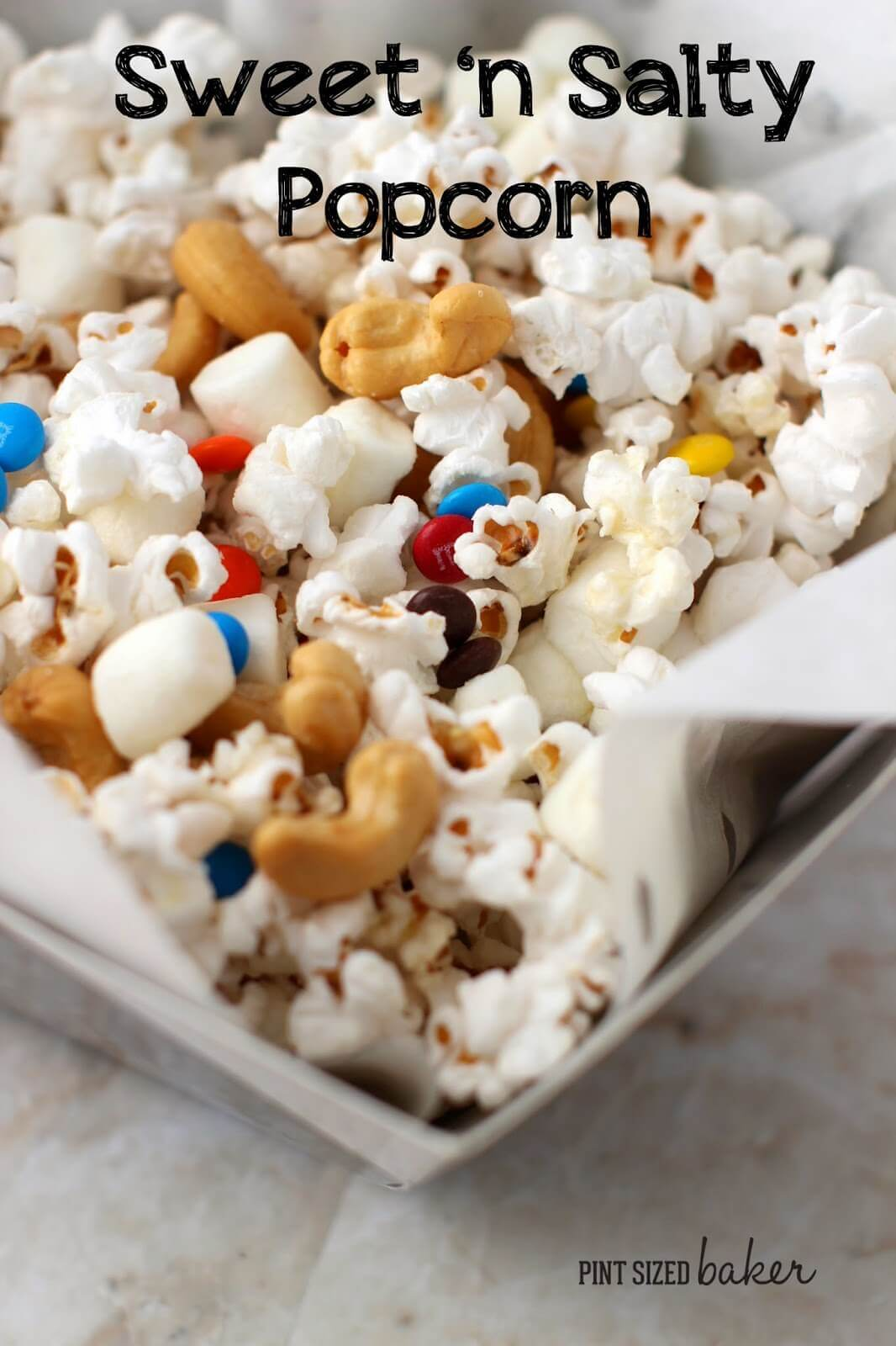 Enjoy some Sweet and Salty popcorn with mini M&M's, mini marshmallows and some salty cashews.