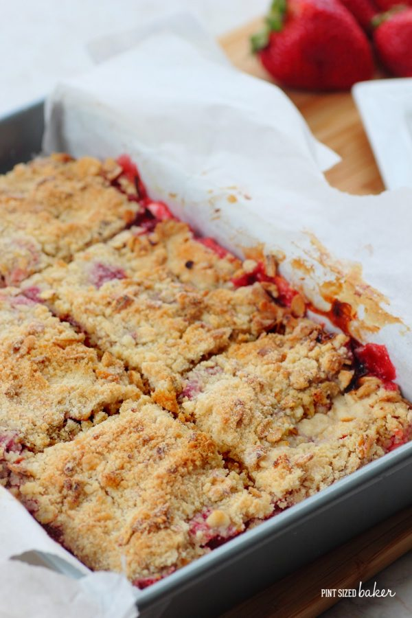 Baked and cooled strawberries and cream cookie crumble bars in the baking pan.