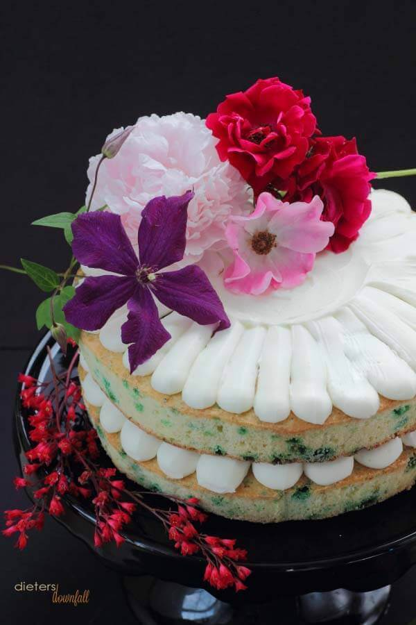 Mint Chips in a pound cake style cake decorated with vanilla frosting and flowers.