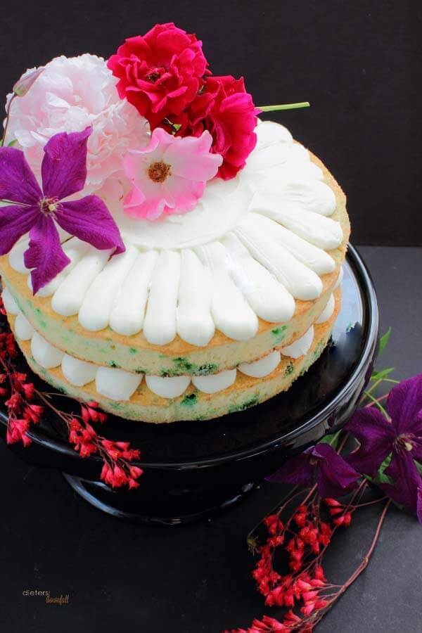 Fresh Flowers always makes a great cake topper. Enjoy some summer roses, clematis, and a peony on your festive cake.