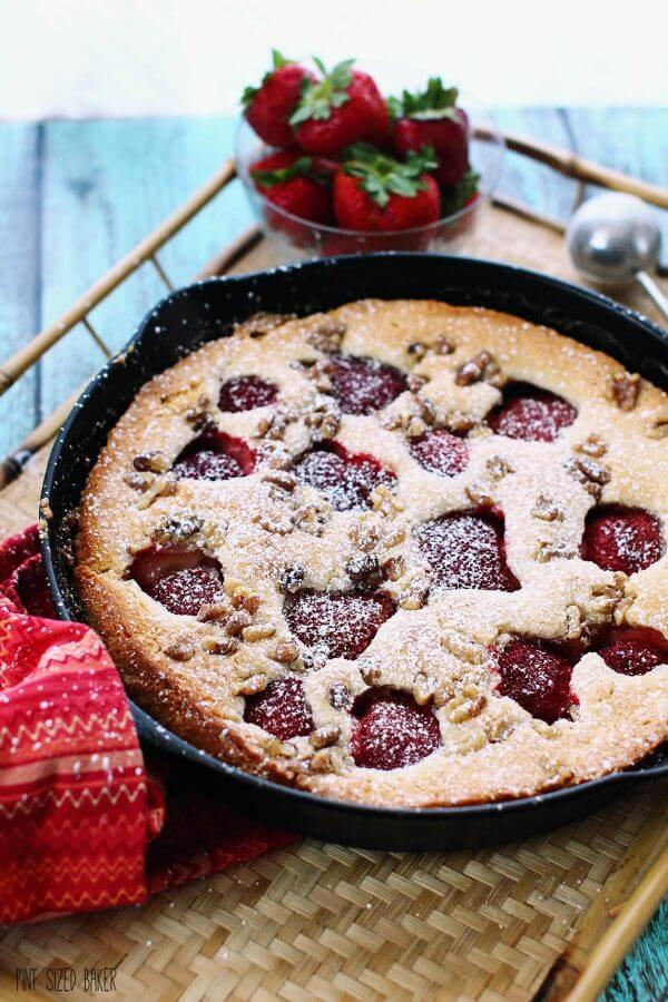 This Strawberry Buttermilk Skillet Cake recipe is simply amazing! It's easy to make and it's so delicious to serve to your friends and family - even on a weekday.