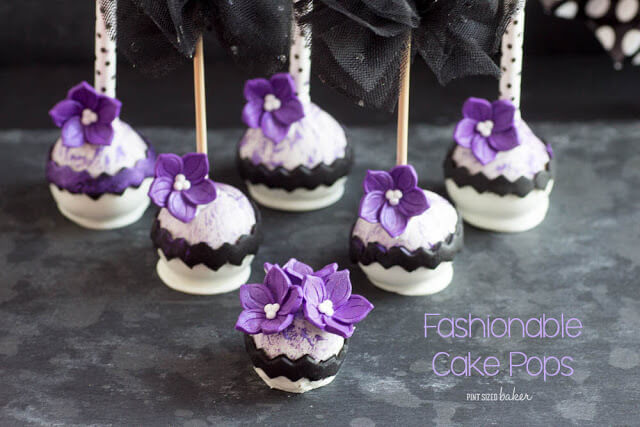 Black and white with a pop of purple! These high fashion cake pops are sure to please the most fashionable girl in town!