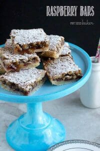Homemade Walnut Raspberry Bars are the perfect mid-day treat with a cup of tea.