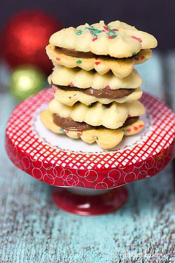 Make some Simple Spritz Christmas Cookies with the kids. Enjoy them one cookie at a time or turn them into cookie sandwiches!