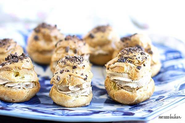 Pastry Puffs full of coffee whipped cream and a coffee glaze and topped with chocolate covered coffee beans. They are so good!!