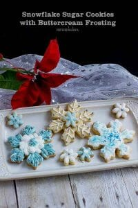 Easy Snowflake Christmas cut out cookies decorated with buttercream frosting. An easy alternative to royal icing.