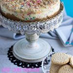 A yummy Sugar Cookie Cheesecake that is full of sugar cookie flavor and tons of rainbow sprinkles. It's a great dessert to brighten up any day!