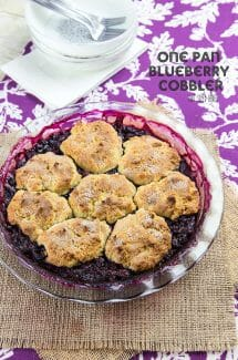 An overhead view of a pie pan of blueberry cobbler.