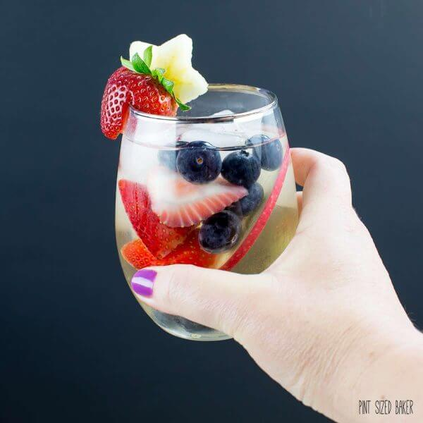 Cheers! Summer loving at its best. This Sangria recipe is the perfect summer refreshment.