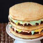 Surprise the men in your life with this fun and delicious Big Mac Cake! It's Three layers of Yellow Cake with Fudgy Brownies and seven minute frosting.