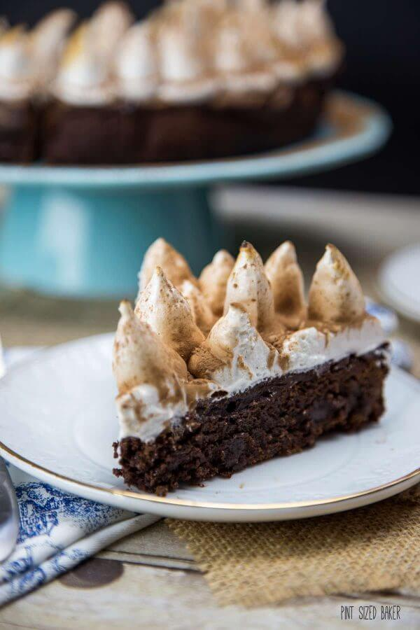 Thick and fudgy Hot Chocolate Brownie with a chocolate layer and topped with toasted marshmallow frosting.