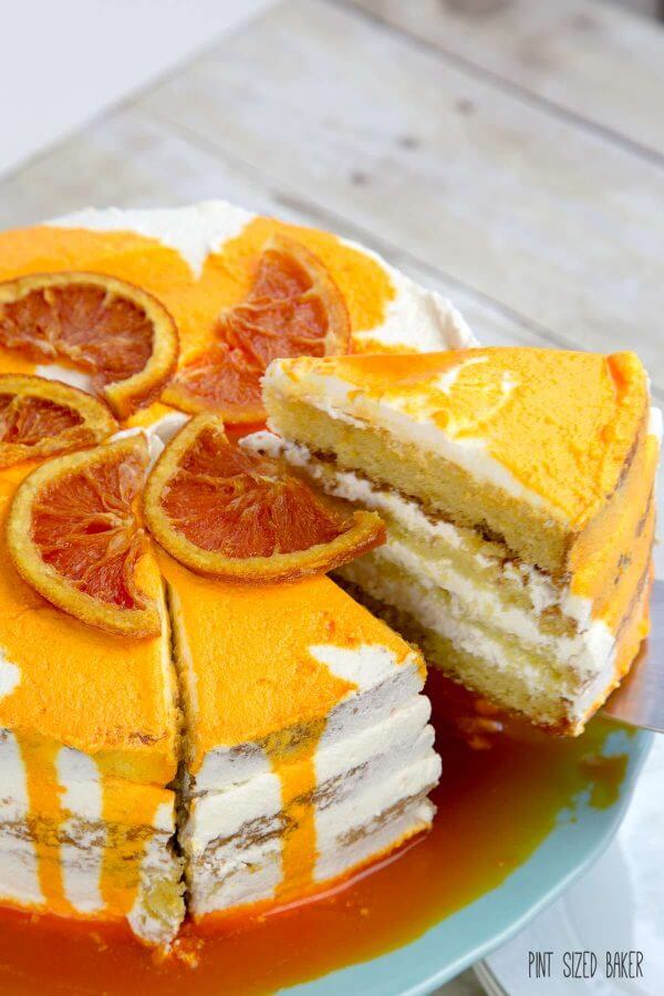 Slicing into this cake reveals four layers of Orange Olive Oil Cake.