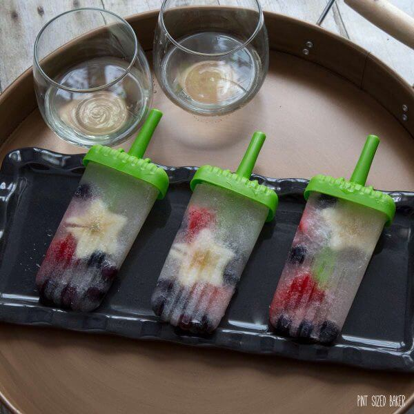 Fresh blueberries, apples, and strawberries are added to this fun and delicious White Wine Spritzer Popsicles.