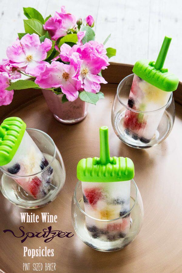 Sweet white wine, some fresh berries and a hint of seltzer makes these White Wine Spritzer Popsicles a hit this summer.