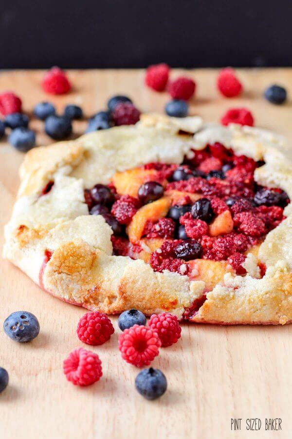 An Galette is an easy dessert that you can whip up quickly. No time for a pie? A galette is a great alternative. This Wineberry Galette is also flavored with peaches and blueberries.