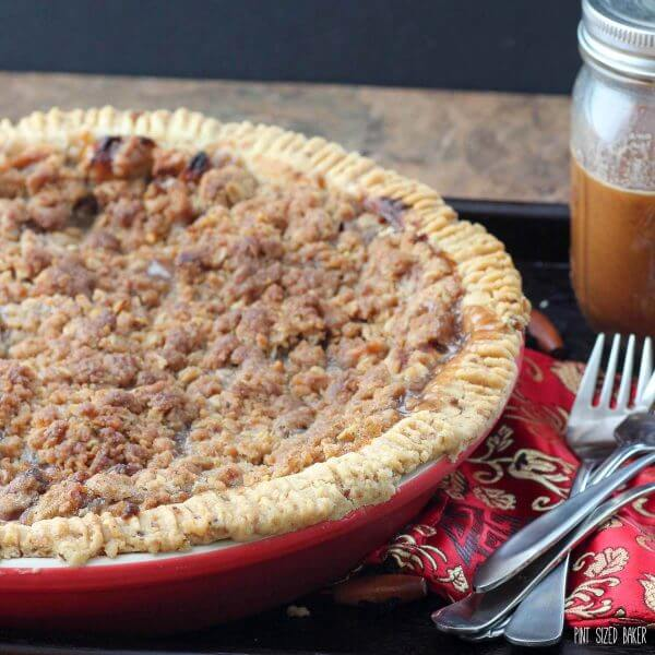 Homemade Dutch Apple Pie just like grandma used to make. Baked in a walnut crust and served with caramel.