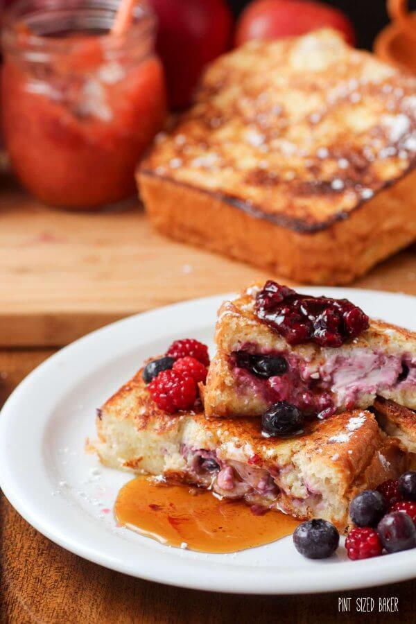Stuffed French Toast served with mixed berry jam and some maple syrup.